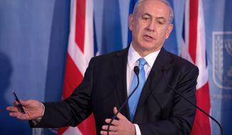 ** FILE ** Israeli Prime Minister Benjamin Netanyahu speaks during a joint press conference with his British counterpart in Jerusalem on Wednesday, March 12, 2014, following their meeting. (AP Photo/Menahem Kahana, Pool)