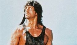 Rambo (Sylvester Stallone) with AK 47 assault rifle.