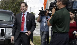 Sen. Marco Rubio, R-Fla., smiles after talking to the media as he leaves the Richard Gerstein Justice Building in Miami, Wednesday, March 12, 2014. Rubio reported for jury duty at a Miami-Dade County courthouse but was not called to serve on a panel. (AP Photo/Alan Diaz)