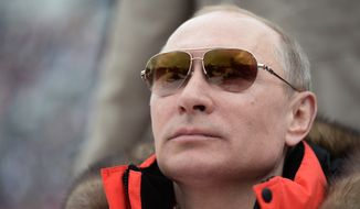In this photo taken Saturday, March 8, 2014, Russian President Vladimir Putin watches downhill ski competition of the 2014 Winter Paralympics in Roza Khutor mountain district of Sochi, Russia. (AP Photo/RIA-Novosti, Alexei Nikolsky, Presidential Press Service)