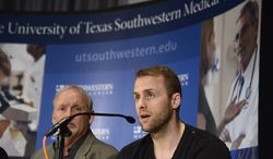Dallas Stars forward Rich Peverley, right, makes a statement regarding his health and the incident which occurred in a recent NHL game during a news conference at UT Southwestern Medical Center as coach Lindy Ruff looks on Wednesday, March 12, 2014, in Dallas. Peverley will not play again this season after he collapsed on the bench during the game. He was diagnosed with an irregular heartbeat in training camp. (AP Photo/Tim Sharp)