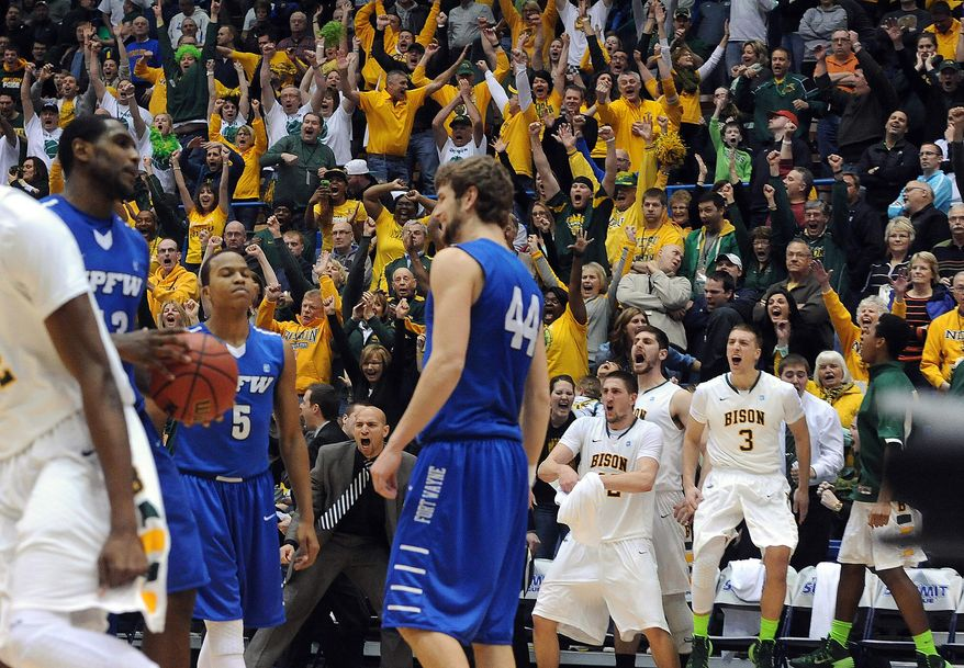 North Dakota State fans cheer after an NDSU score against Indiana-Purdue-Fort Wayne in the closing seconds of an NCAA college basketball game for the Summit League men's tournament title, Tuesday, March 11, 2014, in Sioux Falls, S.D. North Dakota State won 60-57. (AP Photo/Argus Leader, Jay Pickthorn) NO SALES