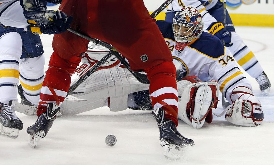 Buffalo Sabres goalie Michal Neuvirth (34), of the Czech Republic, eyes the puck during the second period of an NHL hockey game against the Carolina Hurricanes in Raleigh, N.C., Thursday, March 13, 2014. (AP Photo/Karl B DeBlaker)
