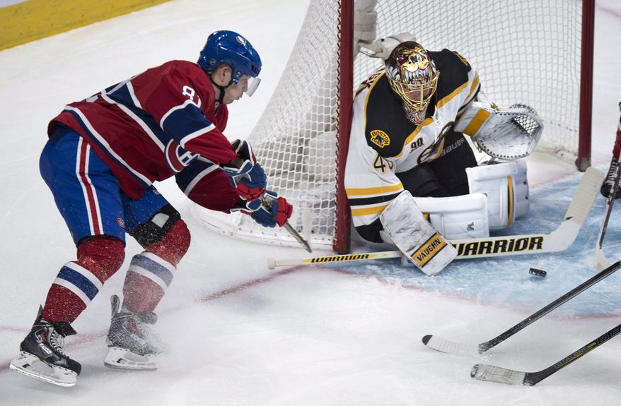Montreal Canadiens' Lars Eller tries to score on the wrap-around past Boston Bruins goalie Tuukka Rask during first period NHL hockey action Wednesday, March 12, 2014 in Montreal. (AP Photo/The Canadian Press, Paul Chiasson)