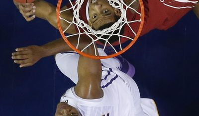 Alabama forward Shannon Hale (11) and LSU forward Jarell Martin (12) watch a loose ball during the first half of an NCAA college basketball game in the second round of the Southeastern Conference men's tournament, Thursday, March 13, 2014, in Atlanta. (AP Photo/John Bazemore)