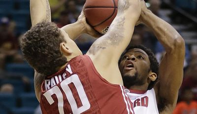 Stanford's Chasson Randle, right, puts up a shot against Washington State's Jordan Railey during the first half of an NCAA college basketball game in the Pac-12 men's tournament, Wednesday, March 12, 2014, in Las Vegas. (AP Photo/Julie Jacobson)
