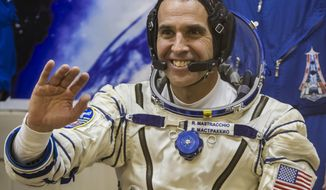 "FILE - This Nov. 7, 2013 file photo shows U.S. astronaut Rick Mastracchio, a crew member of the International Space Station, waving prior to the launch of Soyuz-FG  rocket at the Russian leased Baikonur cosmodrome, Kazakhstan. Mastracchio, along with Japanese astronaut Koichi Wakata will serve as  on-board correspondents for a National Geographic special called ""Live From Space,"" airing Friday, March 14 at 8 p.m. EST on the National Geographic Channel. (AP Photo/Shamil Zhumatov, File)"