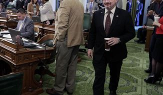 Assemblyman Tim Donnelly, R-Twin Peaks, walks to his desk in the Assembly chamber at the state Capitol in Sacramento, Calif., Thursday, March 13, 2014. Donnelly, a California gubernatorial candidate, said the sudden departure a day earlier of his campaign manager, Jennifer Kerns, will not hamper his push to energize activists during this weekend's GOP convention. (AP Photo/Rich Pedroncelli)