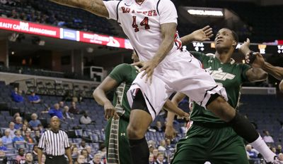 Rutgers forward J.J. Moore (44) drives to the basket in front of South Florida forward Victor Rudd, right, during the first half of an NCAA college basketball game at the American Athletic Conference men's tournament Wednesday, March 12, 2014, in Memphis, Tenn. (AP Photo/Mark Humphrey)