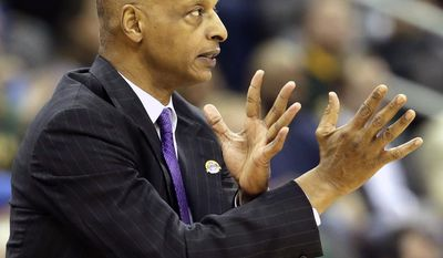 TCU coach Trent Johnson signals his players during the first half of an NCAA college basketball game against Baylor in the Big 12 men's tournament on Wednesday, March 12, 2014, in Kansas City, Mo. (AP Photo/Charlie Riedel)