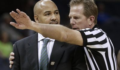 An official explains a foul call to South Florida coach Stan Heath in the first half of an NCAA college basketball game between South Florida and Rutgers at the American Athletic Conference tournament Wednesday, March 12, 2014, in Memphis, Tenn. (AP Photo/Mark Humphrey)