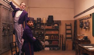 "Ralph Fiennes, left, as head concierge M. Gustave, and Tony Revolori as Zero Moustafa in ""The Grand Budapest Hotel ."" (associated press)"