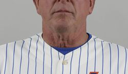 """FILE - This is a Feb. 19, 2013 file photo showing New York Mets pitching coach Dan Warthen posed at spring training in Port St. Lucie, Fla. Warthen and the Mets apologized after the team's pitching coach used a racial slur in describing the translator for New York pitcher Daisuke Matsuzaka. """"I apologize for the thoughtless remarks that I made yesterday in the clubhouse,"""" Warthen said in statement released by the team Wednesday, March 12, 2014.  (AP Photo/Julio Cortez, File)"""