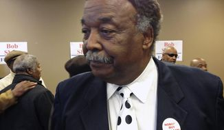 Former Chicago alderman and Cook County commissioner Robert Shaw leaves a news conference Thursday, March 13, 2014, in Chicago after announcing he will run for Chicago mayor. He plans to challenge Chicago Mayor Rahm Emanuel in next year's race. (AP Photo/Sun-Times Media, Jon Seidel)  MANDATORY CREDIT, MAGS OUT, NO SALES