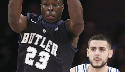 Butler forward Khyle Marshall (23) grabs a rebound as Seton Hall forward/center Aaron Geramipoor (50) looks on during the first half of an NCAA men's college basketball game in the first round of the Big East tournament at Madison Square Garden, Wednesday, March 12, 2014, in New York. (AP Photo/John Minchillo)