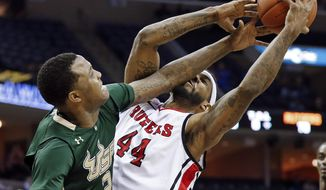 South Florida forward Victor Rudd (2) fouls Rutgers forward J. J. Moore (44) during the second half of an NCAA college basketball game at the American Athletic Conference men's tournament Wednesday, March 12, 2014, in Memphis, Tenn. Rutgers won 72-68. (AP Photo/Mark Humphrey)