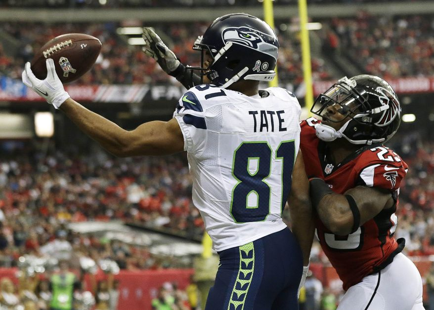 FILE - In this Nov. 10, 2013 file photo, Seattle Seahawks wide receiver Golden Tate (81) makes a touchdown catch against Atlanta Falcons cornerback Robert Alford (23) during the first half of an NFL football game in Atlanta. Tate traveled to Detroit on Tuesday night, March 11, 2014,  to meet with the Lions on Wednesday. (AP Photo/John Bazemore, File)