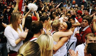 South Dakota players celebrate an 82-71 win over Denver during an NCAA college basketball game for the championship of the Summit League women's tournament Tuesday, March 11, 2014, in Sioux Falls, S.D. (AP Photo/Argus Leader, Joe Ahlquist) NO SALES