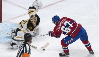 Boston Bruins goalie Tuukka Rask makes a save off Montreal Canadiens' Max Pacioretty during first period NHL hockey action Wednesday, March 12, 2014 in Montreal.  (AP Photo/The Canadian Press, Paul Chiasson)