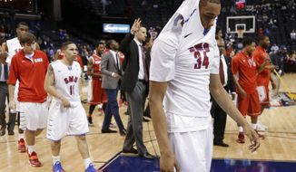 SMU forward Ben Moore (34) leaves the court  after losing to Houston 68-64 in an NCAA college basketball game in the quarterfinals of the American Athletic Conference tournament Thursday, March 13, 2014, in Memphis, Tenn. (AP Photo/Mark Humphrey)
