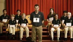 """This photo released by Focus Features shows Jason Bateman, center, in a scene from """"Bad Words."""" (AP Photo/Focus Features, Sam Urdank)"""