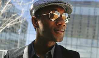 Aloe Blacc poses for a portrait during the SXSW Music Festival on Wednesday, March 12, 2014, in Austin, Texas. He performed during SXSW 2014 at Stubbs on Tuesday at the Def Jam showcase. (Photo by Jack Plunkett/Invision/AP)