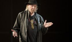 This Tuesday, March 11, 2014 photo shows Neil Young speaking during SXSW 2014 Music Festival in Austin, Texas. (AP Photo/Austin American-Statesman, Jay Janner)