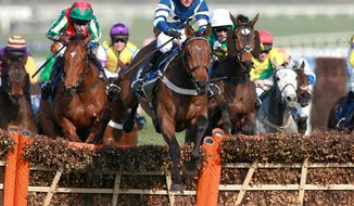 Whisper ridden by Nico de Boinville, centre,  jumps clear to go on to win the Coral Cup during day two of the Cheltenham Festival at Cheltenham Racecourse, Cheltenham England Wednesday March 12, 2014. (AP Photo/David Davies/PA) UNITED KINGDOM OUT