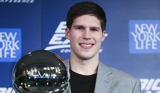 Creighton's Doug McDermott holds his Big East Conference Player of the Year trophy during a media availability before the Big East NCAA college basketball tournament on Wednesday, March 12, 2014, in New York. (AP Photo/John Minchillo)