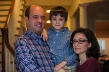 Mark Miller, left, Ellyn Miller, right, and their son Jake, center, pose at their home in Leesburg, Va., on Wednesday, March 12, 2014.  The Senate passed a bill, named for Gabriella, Tuesday that directs $126 million  over the coming decade for childhood cancer research. (AP Photo/Zach Gibson)
