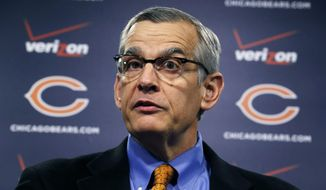 Chicago Bears' general manager Phil Emery talks about free agents, defensive end Lamarr Houston and safety Ryan Mundy, after they were signed during an NFL football news conference Wednesday, March 12, 2014, in Lake Forest, Ill. (AP Photo/Charles Rex Arbogast)