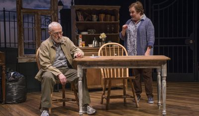 """In this March 6, 2014 photo provided by the Northlight Theatre in Skokie, Ill., actor John Mahoney, 73, plays a scene with Penny Slusher in the final dress rehearsal for """"Chapatti,"""" by Irish playwright Christian O'Reilly. It tells the story of a man living in Dublin with his dog named Chapatti. It runs March 7 to April 13 before going to Galway, Ireland. (AP Photo/Courtesy of the Northlight Theatre, Michael Brosilow)"""