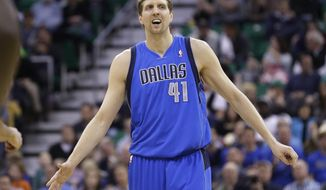 Dallas Mavericks' Dirk Nowitzki (41) looks on after scoring against the Utah Jazz in the second quarter during an NBA basketball game Wednesday, March 12, 2014, in Salt Lake City. (AP Photo/Rick Bowmer)