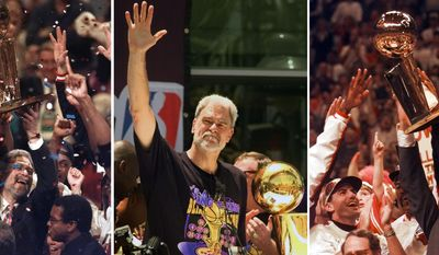 """FILE - At left, in a  June 13, 1997, file photo, Chicago Bulls coach Phil Jackson hoists the NBA Championship trophy aloft after the Bulls beat the Utah Jazz 90-86 in Game 6 of the NBA Finals. in Chicago. At center, in a June 21, 2000 file photo, Los Angeles Lakers head coach Phil Jackson waves to the crowd as the Lakers and thousands of their fans celebrate their NBA Championship in downtown Los Angeles. At right, in a June 16, 1996 file photo, Chicago Bulls coach Phil Jackson hoists the NBA championship trophy after the Bulls beat Seattle in Game 6 of the NBA Finals in Chicago. Carmelo Anthony says he has heard that 11-time NBA champion coach Phil Jackson will be """"coming on board"""" in a leadership capacity with the New York Knicks, though cautioned that nothing is yet official. Anthony made the comments Wednesday, March 12, 2014, to reporters in Boston, where the Knicks are playing the Celtics. (AP Photo/File)"""