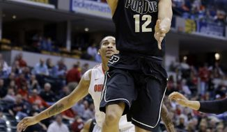 Purdue guard Bryson Scott goes up for a layup in the first half of an NCAA college basketball game against Ohio State in the first round of the Big Ten Conference tournament Thursday, March 13, 2014, in Indianapolis. (AP Photo/Michael Conroy)