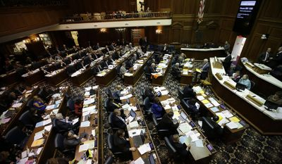 The Indiana House of Representatives listens to debate of the final day of the 2014 legislative session at the Statehouse in Indianapolis, Thursday, March 13, 2014.  (AP Photo/AJ Mast)