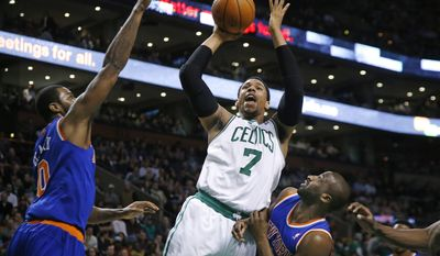 Boston Celtics center Jared Sullinger (7) shoots against New York Knicks forward Earl Clark (0) and guard Raymond Felton during the second quarter of an NBA basketball game in Boston, Wednesday, March 12, 2014. (AP Photo/Elise Amendola)