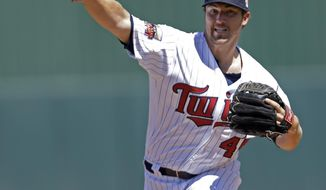 Minnesota Twins pitcher Phil Hughes warms up in the first inning of an exhibition baseball game against the Boston Red Sox in Fort Myers, Fla., Thursday, March 13, 2014. (AP Photo/Gerald Herbert)
