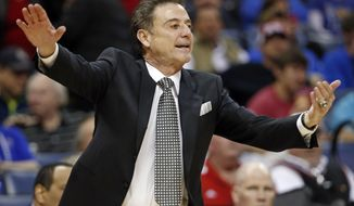 Louisville head coach Rick Pitino directs his players during the first half of an NCAA college basketball game against Rutgers in the quarterfinals of the American Athletic Conference tournament Thursday, March 13, 2014, in Memphis, Tenn. (AP Photo/Mark Humphrey)