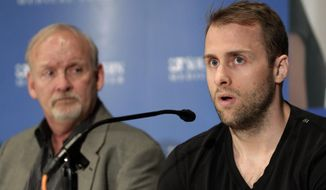 CORRECTS DATE TO MARCH 12 - Dallas Stars forward Rich Peverley, right, makes a statement regarding his health and the incident which occurred in a recent NHL game during a news conference at UT Southwestern Medical Center as coach Lindy Ruff looks on Wednesday, March 12, 2014, in Dallas. Peverley will not play again this season. (AP Photo/Tim Sharp)
