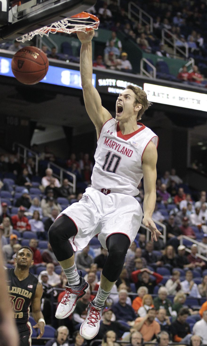 Maryland's Jake Layman (10) dunks against Florida State during the first half of a second round NCAA college basketball game at the Atlantic Coast Conference tournament in Greensboro, N.C., Thursday, March 13, 2014. (AP Photo/Bob Leverone)