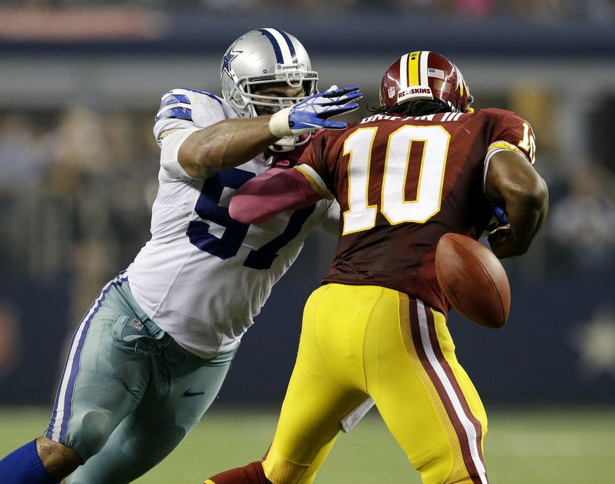 Dallas Cowboys defensive tackle Jason Hatcher (97) sacks Washington Redskins quarterback Robert Griffin III (10) forcing him to fumble in the second half of an NFL football game, Sunday, Oct. 13, 2013, in Arlington, Texas. (AP Photo/LM Otero)