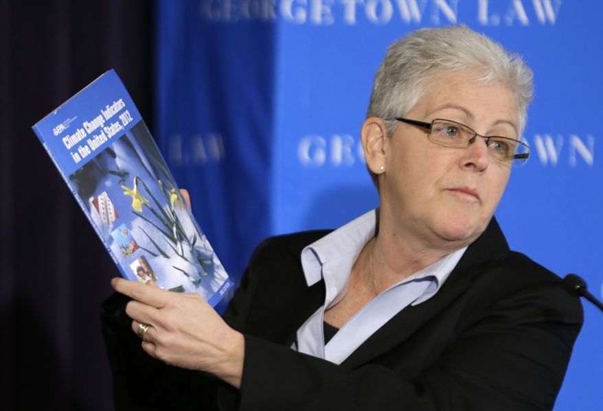**FILE** Gina McCarthy, administrator of the Environmental Protection Agency, holds a climate change report as she speaks at a climate workshop sponsored by The Climate Center at Georgetown University, Thursday, Feb. 21, 2013 in Washington. (AP Photo/Alex Brandon)