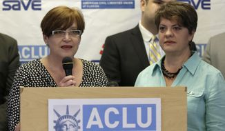Sandra Newson, left, talks to reporters as Denise Hueso, listens during a news conference in Miami Beach, Fla. on Thursday, March 13, 2014.    Howard Simon, Executive Director American Civil Liberties Union of Florida, announced that eight gay couples and the ACLU have filed a federal lawsuit seeking to force Florida to recognize same-sex marriages performed in other states.  Newson, who is a plaintiff in the lawsuit along with wife Denise Hueso, said the couple moved from Miami to Massachusetts so they could get married in 2009. They adopted a son, now 15, who has cerebral palsy and they decided to move back to South Florida, where they had more family to help care for him.   (AP Photo/Alan Diaz)
