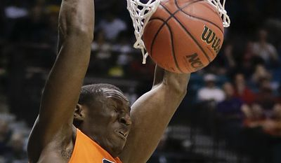 Oregon State's Daniel Gomis dunks against Oregon in the first half of an NCAA college basketball game in the Pac-12 men's tournament, Wednesday, March 12, 2014, in Las Vegas. (AP Photo/Julie Jacobson)