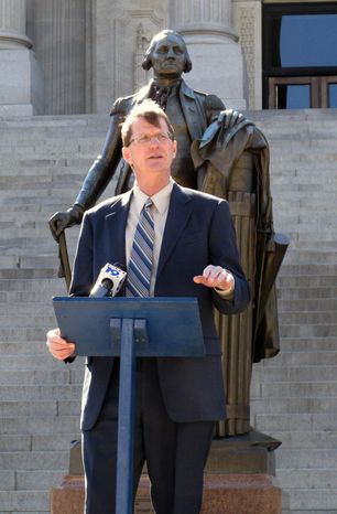 Republican U.S. Senate candidate Richard Cash speaks after signing an agreement to support any challenger who gets into a runoff with U.S. Sen. Lindsey Graham in June, on the steps of the Statehouse, Thursday, March 13, 2014, in Columbia, S.C. Six GOP candidates have said they want to take on Graham as he seeks a third term. (AP Photo/Jeffrey Collins)