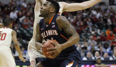 Illinois guard Rayvonte Rice drives against Indiana forward Will Sheehey during the first half of an NCAA college basketball game in the first round of the Big Ten Conference tournament Thursday, March 13, 2014, in Indianapolis. (AP Photo/Kiichiro Sato)