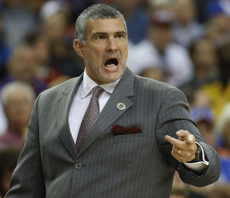 South Carolina head coach Frank Martin speaks to players against Auburn during the first half in a first round Southeastern Conference tournament game, Wednesday, March 12, 2014, in Atlanta. (AP Photo/John Bazemore)