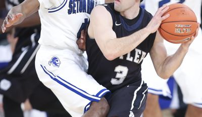 Butler guard Alex Barlow (3) looks to pass around Seton Hall guard Sterling Gibbs (4) during the first half of an NCAA men's college basketball game in the first round of the Big East tournament at Madison Square Garden, Wednesday, March 12, 2014, in New York. (AP Photo/John Minchillo)