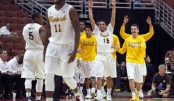 Long Beach State players celebrates a 3-point basket against Cal State Fullerton in the second half of NCAA college basketball game in the Big West Conference men's tournament in Anaheim, Calif., Thursday, March 13, 2014. Long Beach State won 66-56. (AP Photo/Alex Gallardo)